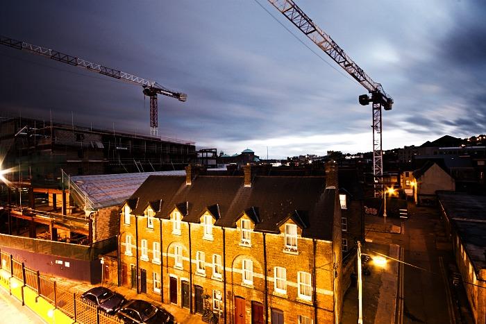 Construction cranes at night